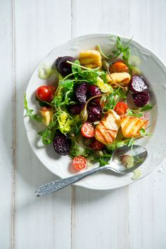 Beetroot + Halloumi Salad. 8 medium-sized beetroots, 10 slices halloumi, 8mm thick, pan fried  ± 15 caper berries, 1 celery stalk, thinly sliced  3 handfuls rocket  1 handful cherry tomatoes, halved  Method Preheat the oven to 180°C  Roast the whole beetroots till very tender. Once cool peel and quarter them. In a serving dish place the cooked beetroot, top with the halloumi slices, caper berries, thinly sliced celery & cherry tomatoes.  Drizzle with balsamic vinegar and extra virgin olive oil.
