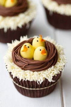 Adorable Easter cupcakes with peeping chicks in a chocolate nest