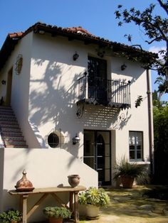 Beautiful Spanish Colonial/OUTSIDE HOUSE STEPS WITH SPANISH TILE; IRONWORK ON PORTHOLE WINDOWS