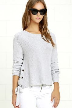 Come get cozy in the Laced in Love Grey Sweater and you'll see why we're so obsessed! Medium-weight knit shapes a rounded neckline, long sleeves, and a wide-cut bodice with silver grommets, plus wide laces along the sides.