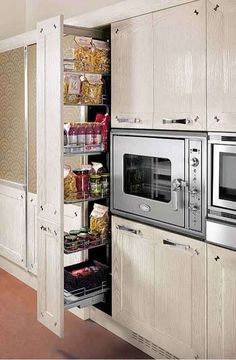 Ultra-Extravagant Kitchens.  I would love to have this pull-out pantry in my remodel.