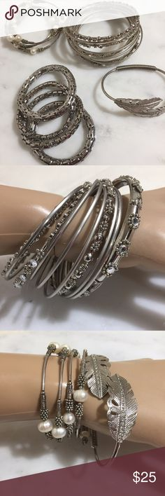 """🔥Silver Tone Bracelets Galore The large set is NWOT. Filigree and crystals on 4 of the bracelets the remaining 6 are plain. 2 5/8"""" diameter  The bracelet with faux pearls and beads is a wrap around.  The bracelet with leaves is s cuff bracelet that separates at the top.  The last set is 4 bracelets that stretch. The links all separate apart.  All are silvertone and no name.  Bin JB Jewelry Bracelets"""