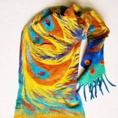 Bright unusual scarf hand painted on pure silk and is made with Australian Merino wool and Wensleydale wool. Silk painting in cold batik technique.Scarf made by me in nunofelting technique. Nunofelting is felting wool on silk using a soap solution.   Emphasize your femininity and individuality. This item may be worn with casual wear and special occasions. Size 40cm by 180cm or 16/71 All my stuff I send in special gift bags, made by me.  1 . Dispatch time - All items,except custom order...