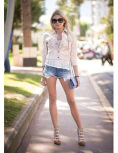 Cannes street style 2014 ELLE UK Angelica Mastyugina wears Miu Miu jacket, Hollister shorts and Chanel bag with Valentino shoes. #Handbags