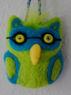 Needle felted, soft sculpture owl made from corriedale wool roving.