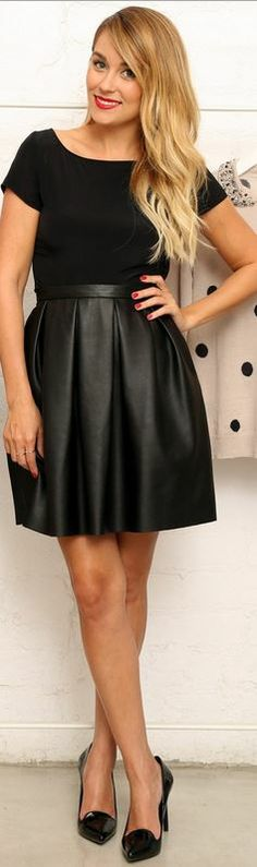 Black short sleeve top and leather pleated skirt