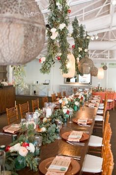 a desert chic wedding reception with hanging florals - photo by Amy & Jordan Photography