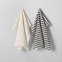 Simple yet full of style, this Kitchen Towel Set from Hearth & Hand™ with Magnolia will find its rightful place in your living space. Coming as a two-pack — one with a cream background and black X pattern and one with black stripes — these hand towels find the perfect contrast in their patterns and add charm to your home. Keep them hung on your oven handle as a warm accent that makes your kitchen feel homey and lived in.<br><br>Celebrate the everyd...