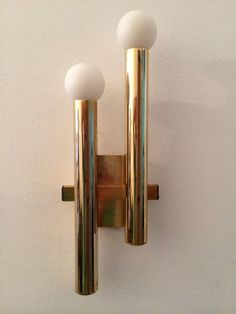 Pair of Sciolari Wall Lights, 1960s | From a unique collection of antique and modern wall lights and sconces at https://www.1stdibs.com/furniture/lighting/sconces-wall-lights/