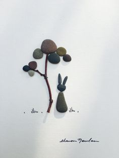 8 by 10 bunny pebble art by sharon nowlan by PebbleArt on Etsy Pebble Stone, Pebble Art, Stone Art, Pebble Pictures, Stone Pictures, Stone Crafts, Rock Crafts, Glass Shadow Box, Daisy Art