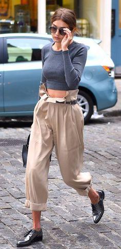 Gigi Hadid shows you how to style high-waisted pants.