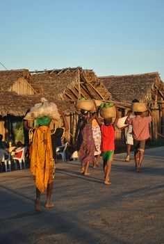 A few Malagasy women carrying food home. Jessie writes about her experience w/ gender inequality as a #PeaceCorps volunteer in #Madagascar.
