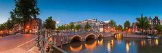 Fotobehang: Amsterdamse Grachten bij Zonsondergang