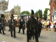 ▶ Wimborne Folk Festival  in Dorset, UK Traditional English Folk Dancing performed by Hunter's Moon, Phoenix Morris, Bourne and Bumpers, Steps in Time. With the Norman Wimborne Minster as backdrop