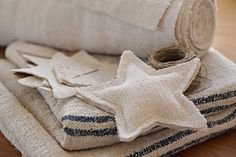 Antique linen stars hung with jute twine. I want to make about a hundred for my tree this year!