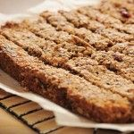 Bonne Maman Raspberry Granola Bars  |||  Ingredients: 1 cup pecans, chopped + 1 1/2 cups all-purpose flour + 1 1/4 cups old-fashioned rolled oats + 1/3 cup granulated sugar + 1/3 cup packed dark brown sugar + 1 tsp salt + 1/2 tsp baking soda + 1 1/2 sticks unsalted butter, melted, plus more for greasing the pan + 1 cup Bonne Maman Raspberry Preserves
