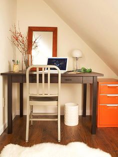 One Bright Hue  An attic eave is just enough space for a home office. Low-profile furniture, such as the desk, stainless-steel chair, and miniature table lamp, works well in the small area. A bright orange filing cabinet adds fun and modern flair to the work space.