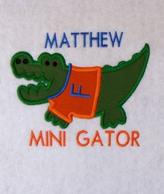 Embroidered boy GATOR's football onesie or T shirt. $22.50, via Etsy.