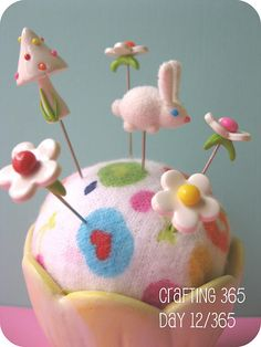 pincushion art - imagine this as a ball of felted wool, needle felted, and in a cute little cup/basket :)