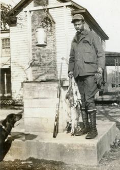 1930s  American Hunter with Rabbits