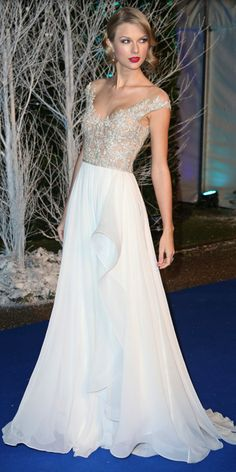 CELEBRITY/RED CARPET FAVES:: Taylor Swift in REEM ACRA. Another view of this gorgeous dress -- small draping detail just below waist beautiful touch. @Cindy London-O'D/Love2BeadbyCindy