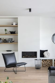 """Lifs interior advice & styling www.nl Photo: Denise Keus – """"Stylish Living"""" – Sanoma Regional Belgium N. White Fireplace, Living Room With Fireplace, New Living Room, Fireplace Design, Home And Living, Living Room Decor, Living Spaces, Scandinavian Fireplace, Fireplace Ideas"""