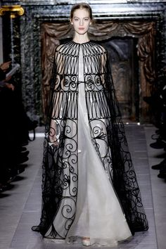 #1 Valentino Spring/Summer 2013 cloak is long and sleeveless which is the style of the paenula the Romans wore. For women the paenula was worn for traveling purposes.