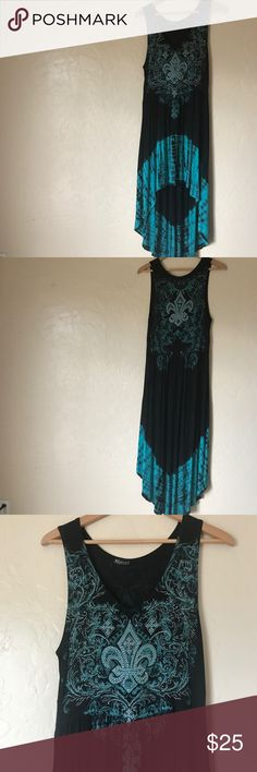 Stunning High Low Black and Turquoise Dress! This dress is simply stunning. Bold turquoise and black tie dye with iridescent rhinestone fleur de lis. Empire waisted. Incredibly soft! So comfy! And still gorgeous! No size tag but it's an L-XL. Dresses High Low