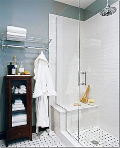 Open Design Tall, clear-glass shower doors emphasize the small bath's high ceilings and create the illusion of more room. The white subway tile and chrome fixtures reflect light, contributing to the sense of spaciousness. Basket-weave tile covers the floor and carries into the shower for continuity.