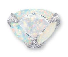 A Diamond and White Opal Ring. Centering upon a shield-shaped rose-cut diamond weighing approximately 5.36 carats, overlapping a triangular-shaped white opal, joined by circular and oval-shaped rose-cut diamond openwork prongs with brilliant-cut diamond trim, mounted in 18k white gold.