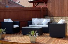Amazing Patio Outdoor Sofa Rattan Furniture Design with Square Glass Table and Wood Flooring Also Using Fence