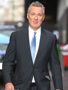 Who's that man? Martin Kemp debuted a new grey look on Monday morning in central London