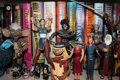 Random Action Figures on a Shelf.