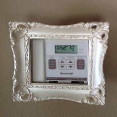 Small frame on my thermostat. Use 3M command hook/loop strips to attach.
