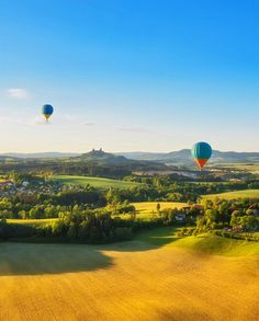 Balloons over the Bohemian Paradise, Czechia (Trosky castle ruins in the background)