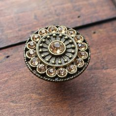 Hey, I found this really awesome Etsy listing at http://www.etsy.com/listing/165996999/crystal-drawer-knobs-with-topaz-glass