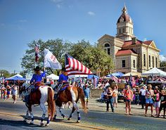Parade in Bandera., Texas w/Court House in background