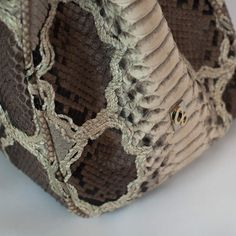 Detail of back-cut python leather by GLENI