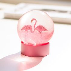 Flamingo Snow Globe - Flip the bird