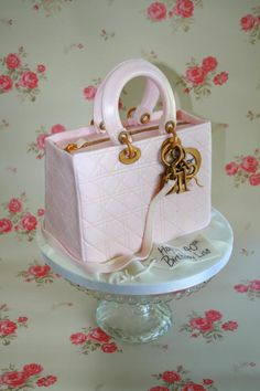 At last I get to make a handbag cake. I thoroughly enjoyed making it and I can't wait for another bag cake they are cool. I did not get the shine I was hoping for can anyone suggest any tips? It should have been glossy!