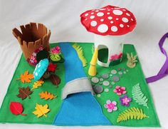 Lovely woodland themed felt play mat with woodland creatures. What you get: felt play mat, mushroom house, hollow tree trunk, a yellow pixie, a mushroom peg doll and 2 felt bushes . The mat measures 35x45 cm. Some parts are machine sewn, some hand sewn and some glued on. Not suitable for