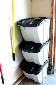 Last but not least, some stacking bins tuck perfectly in the corner, to hold all sorts of garage goodies from shop vac attachments to life jackets and kid's tackle boxes!
