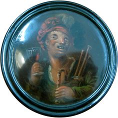 A Hand Painted Papier Mache Snuff Box with the image of a drinking minstrel. This dates to about 1850 and is European and is in excellent condition