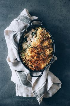 Loaded cauliflower casserole with kale and chickpeas, perfect for the Thanksgiving dinner! #vegan #healthy #thanksgiving #foodstyling #foodphotography | TheAwesomeGreen.com