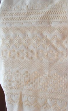 cream on white huck embroidery/weaving