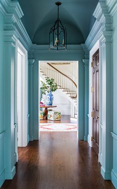 Atlanta Homes & Lifestyles From a beautiful turquoise blue hallway we have a peek into the foyer with a dramatic blue and white Chinese porcelain vase. Classical Architecture, Architecture Details, Beautiful Architecture, Interior Architecture, Decor Interior Design, Interior Decorating, Blue Hallway, Georgia Homes, Coastal Living Rooms