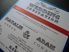Carnival Style font - flat back style Wedding invitation with royal blue base and coral coloured ribbon