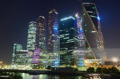 View of skyscrapers on Moscow-City (Moscow International Business Center or Moskva-City) at night. Located on the banks of the Moskva River (Moscow River). Moscow, Russia.