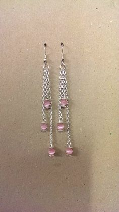 A pair of Cats Eye Gemstone Earrings with added chain and daisy spacer beads.