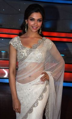 Gorgeous crystal encrusted blouse and net sari.